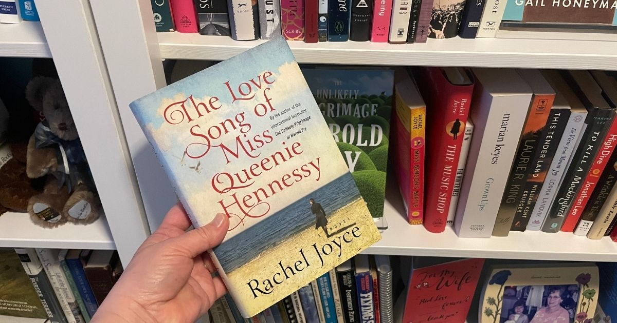 The Love Song of Miss Queenie Hennessy being held by bookshelf