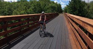 Myrna biking on the Gandy Dancer Trail