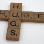 Scrabble tiles spelling out Huge Hugs