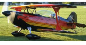 Black, red, orange and yellow Christen Eagle II airplane