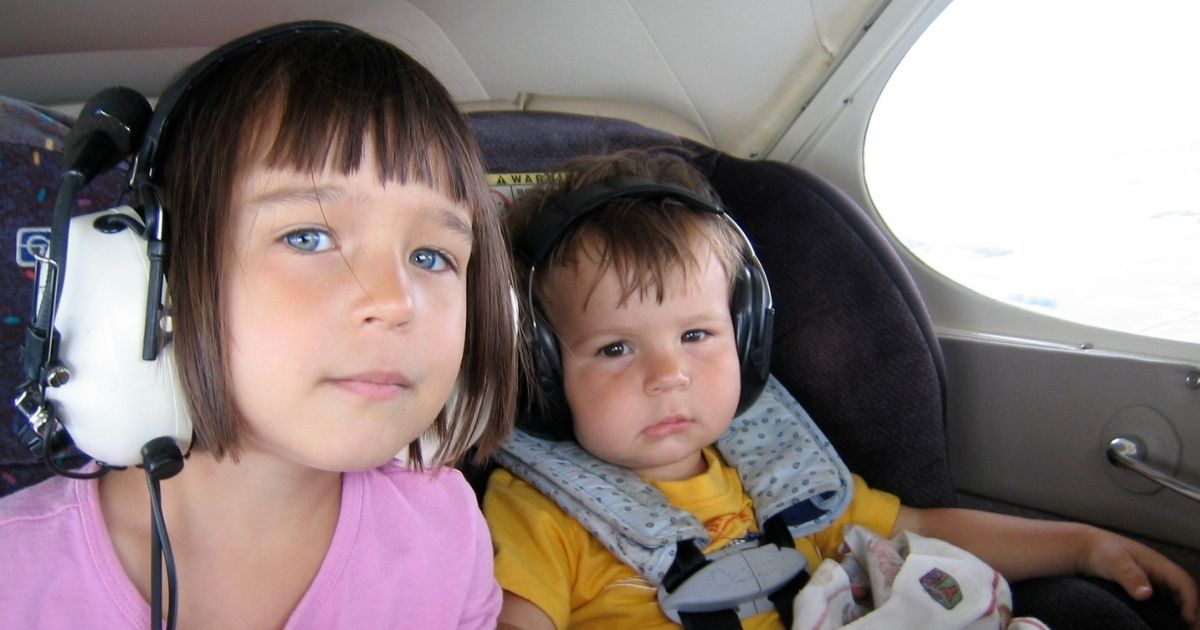 My kids in the back of our Piper Pacer