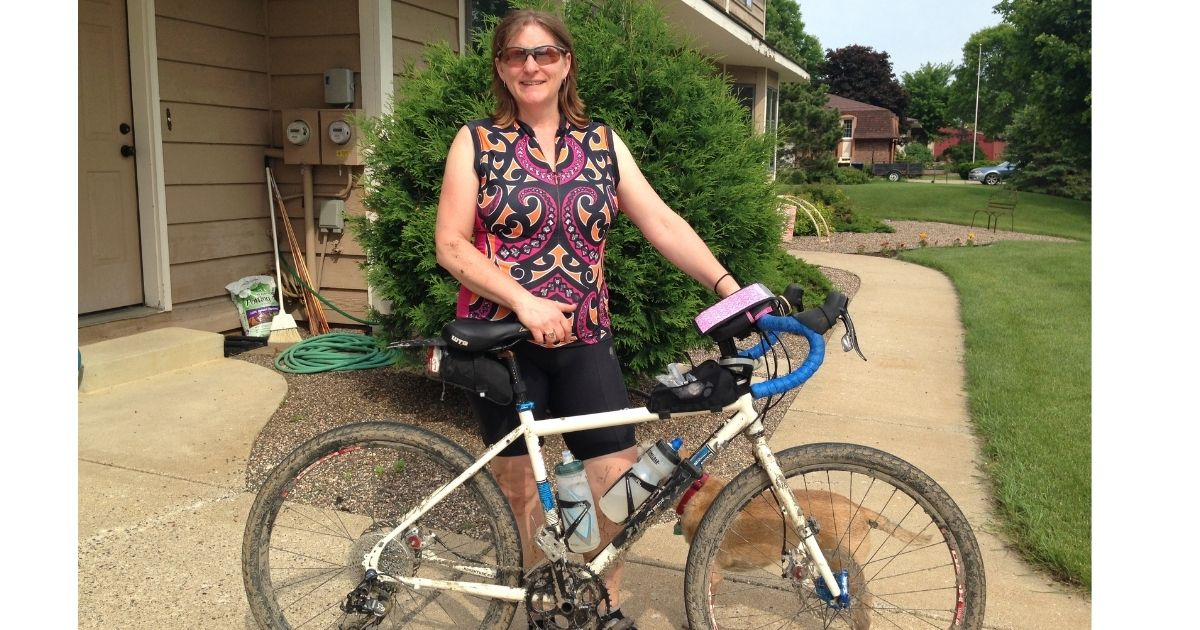 Woman standing next to Salsa Vaya gravel bike
