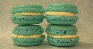 Four turquoise blue macarons