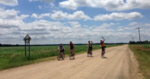 Four women gravel bikers biking together