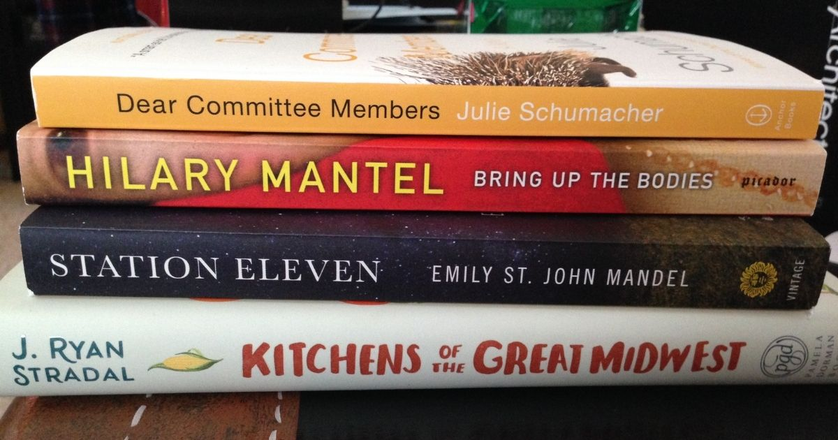 A stack of four books