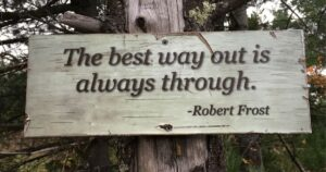 Robert Frost quote on sign